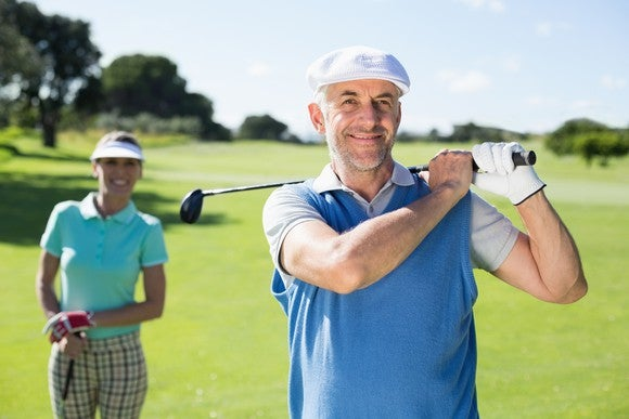 A husband and wife playing golf