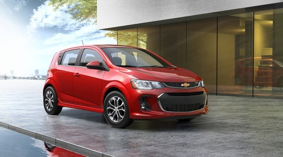 A red 2017 Chevrolet Sonic hatchback.