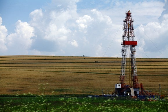 Color shot of a shale gas drilling rig on a field.