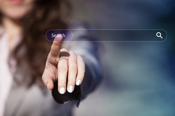 Woman pointing to an online search bar