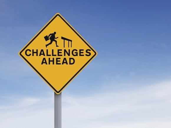 "A road sign saying ""Challenges Ahead"""
