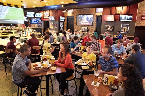 A B-Dubs location on game day, happy guests at every table.
