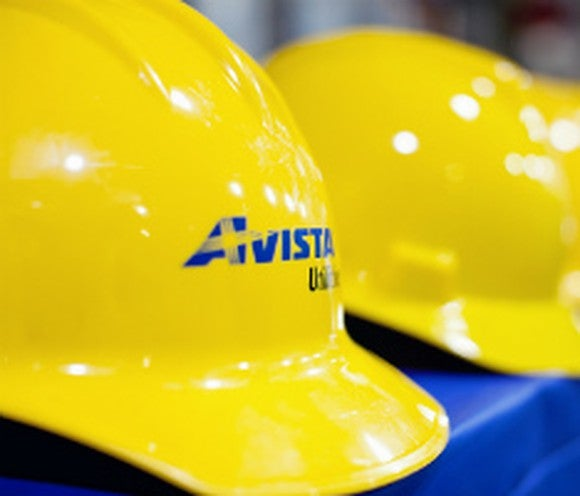 A close-up of a yellow Avista hard hat.