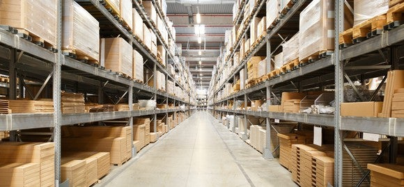 Boxes stacked on shelves in a supply chain warehouse