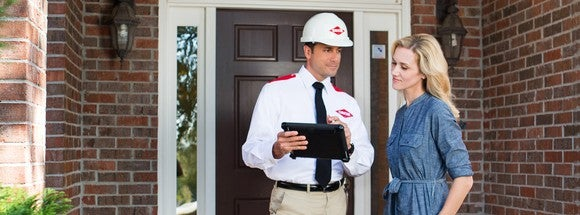 An Orkin pest control specialist speaking with a customer