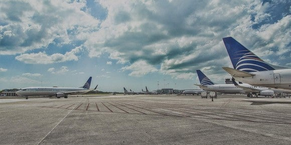 Several Copa Airlines planes sitting on the tarmac.