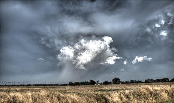 An oil well with a storm approaching.