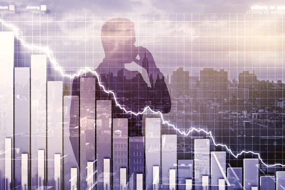 Man's silhouette imposed on declining stock chart