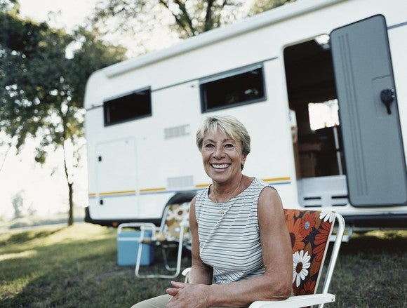 Woman sitting in front of an RV
