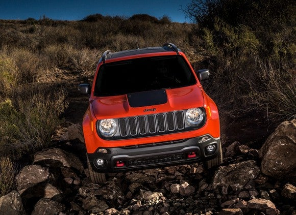 A red Jeep Renegade driving offroad