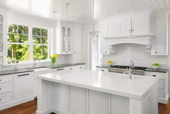Kitchen with both white and grey countertops.