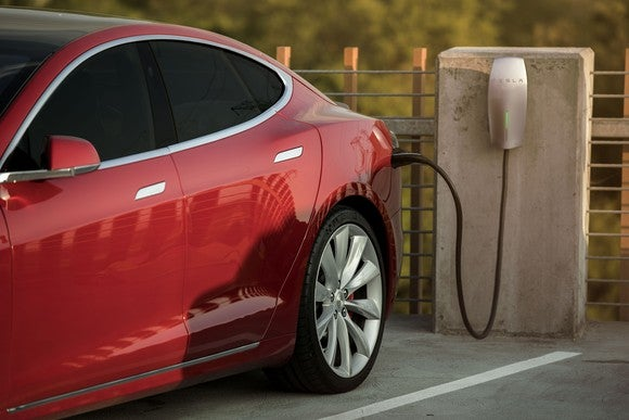 Red Model S charging at a Tesla Destination Charging site