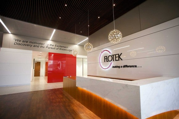 Lobby of a Flotek Industries building, with the company logo on the wall.