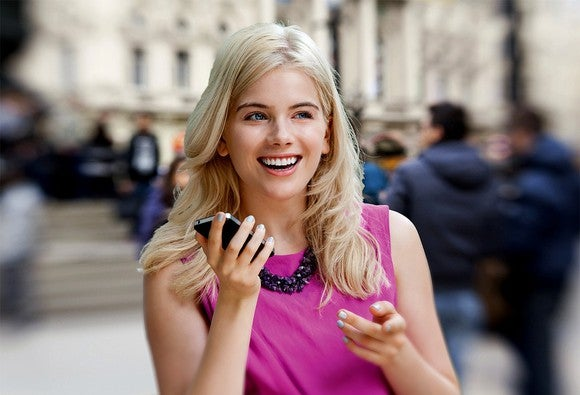 A woman holding a smartphone.