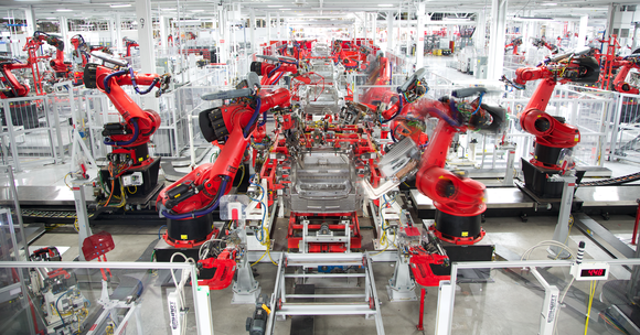 Robots manufacturing vehicles at Tesla's Fremont factory