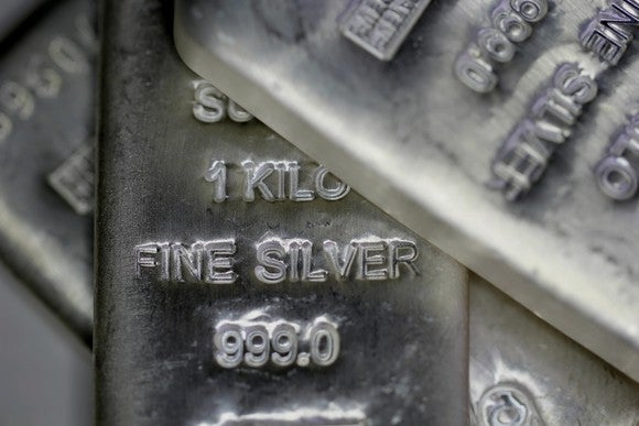 "Silver kilogram bars stamped with ""fine silver"" and ""999.0"" purity stamps."