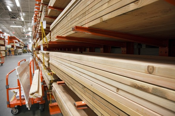Stacks of lumber laid out at a home improvement warehouse.