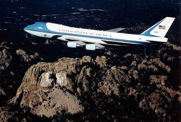 Air Force One flying over mountains