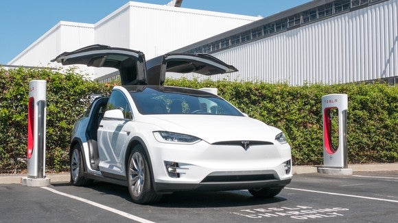 Tesla Model X charing at a Tesla Supercharger location outside of the company's vehicle factory