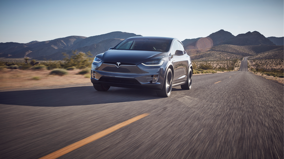 Model X driving on a mountain road