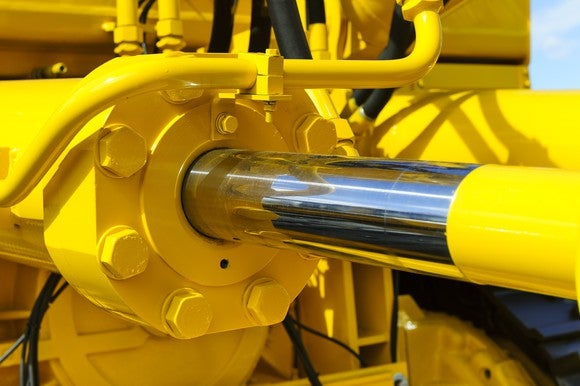 Large, yellow hydraulic piston in extended position.