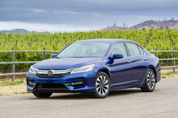 A blue 2017 Honda Accord Hybrid sedan parked on a country road.