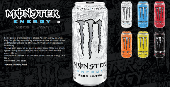 Various cans and colors of Monster Beverage products.