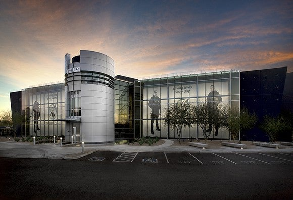 Axon Enterprise's headquarters with graphics of law enforcement on the windows.