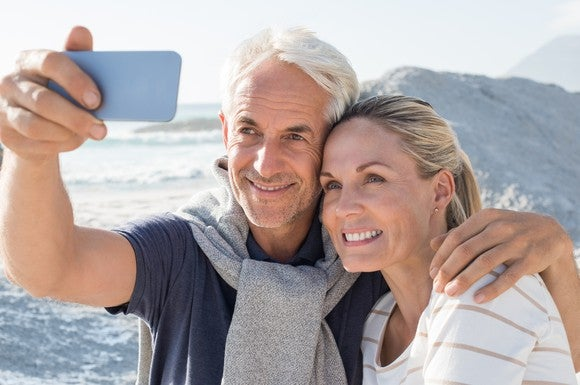 Older couple taking a selfie amidst a scenic backdrop