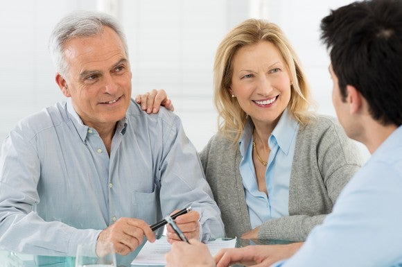 An older couple talking to a financial planner