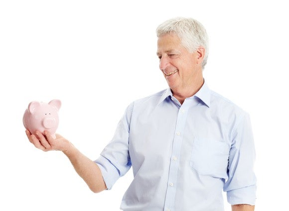 Older gentleman with a piggy bank in hand