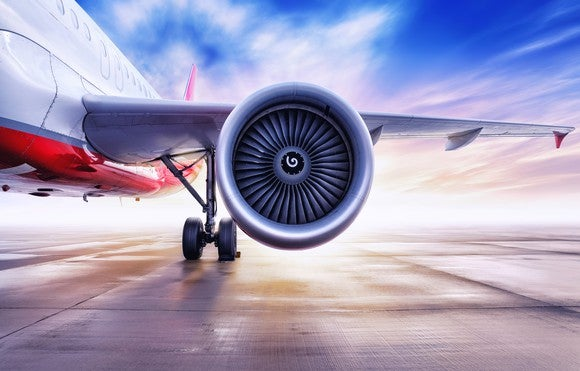 A jet engine is featured, part of a plane sitting on the tarmac.