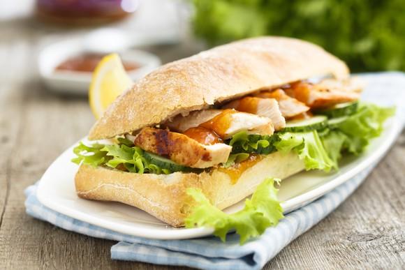 Grilled chicken sandwich with ciabatta bread.