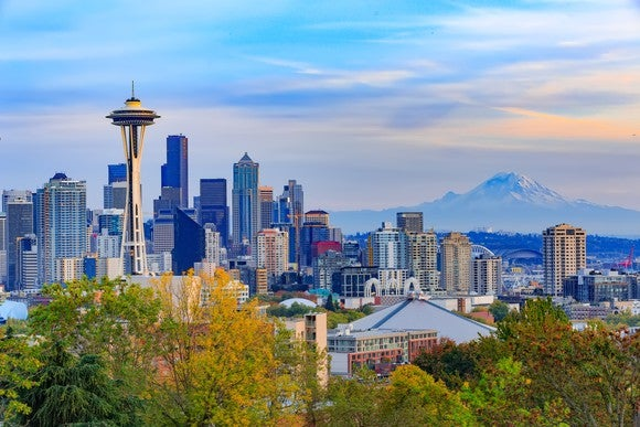 The Seattle skyline, showing the Space Needle to the left and Mount Rainier to the right.