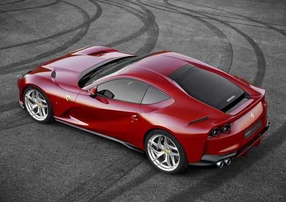 A red 2018 Ferrari 812 Superfast sports car, seen from above.