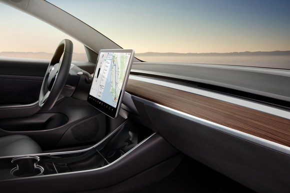 Model 3 interior, highlighting the vehicle's 15-inch touch display and its minimalistic design.