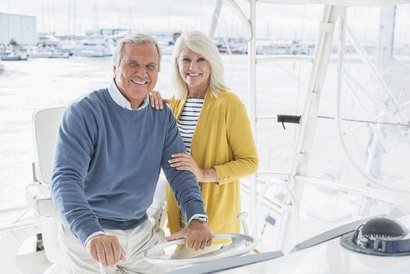 A smiling elderly couple on a boat.