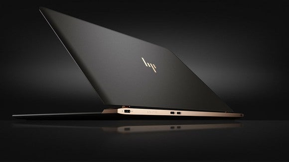 HP's Spectre laptop opening against a black background.