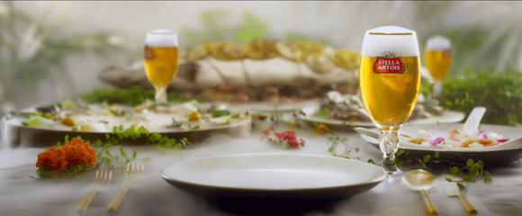 Glasses of Stella Artois on table with dinner