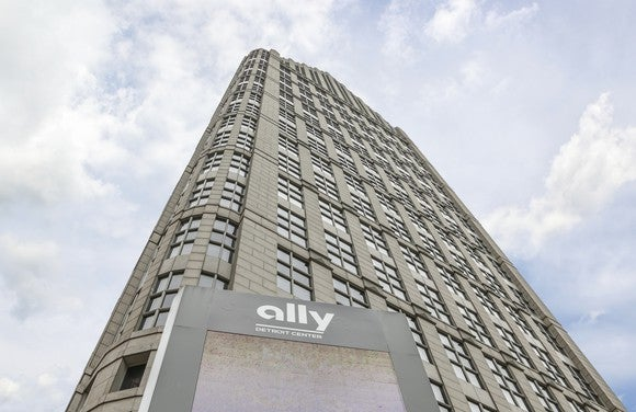 A picture of the Ally Financial Center, looking up the building with the sky in the background