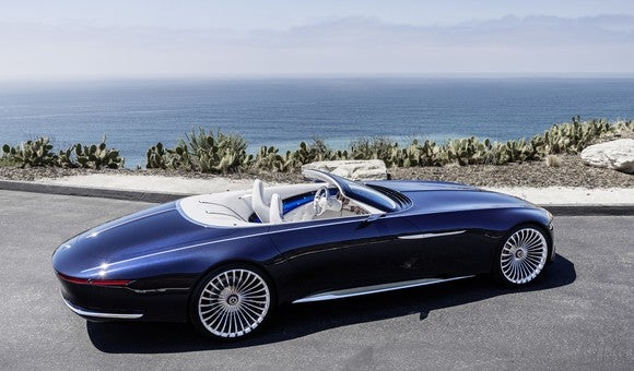 The Vision Mercedes-Maybach 6 Cabriolet, photographed near the ocean at an angle that shows its considerable length.