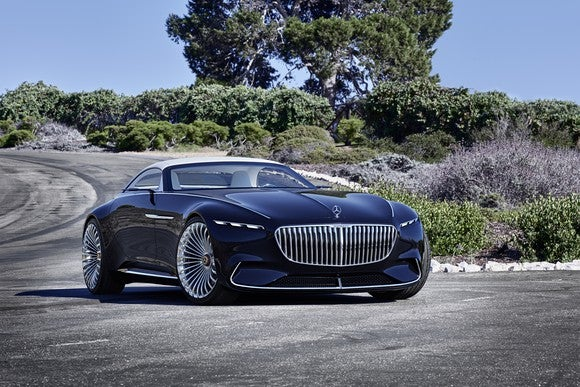 The Vision Mercedes-Maybach 6 Cabriolet, posed on a California coastal road in bright sunlight and viewed from a front quarter-angle.