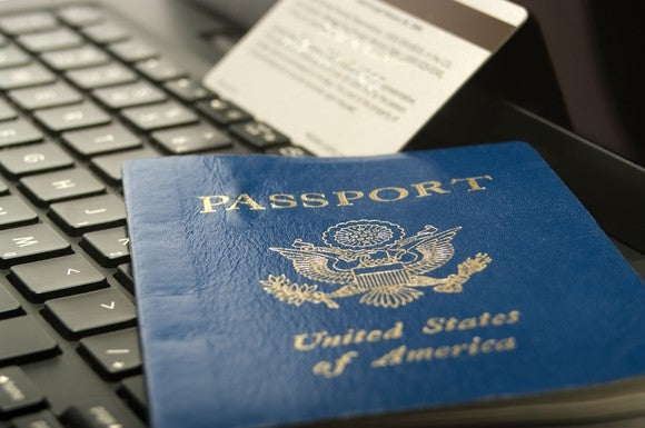 Close-up of a Passport laying on a laptop with a credit card in the background