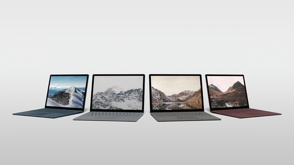 Four Microsoft Surface laptops.