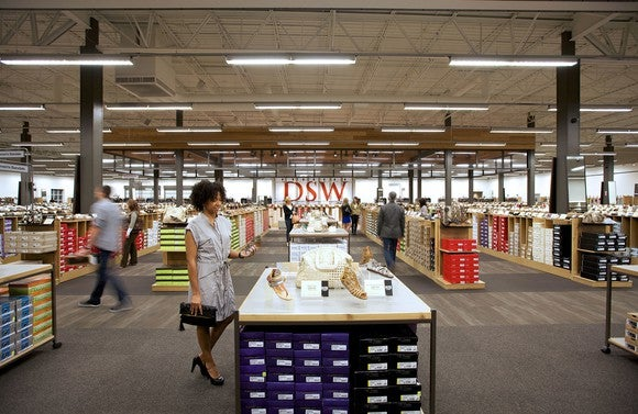 DSW shoe store interior with several shoppers browsing
