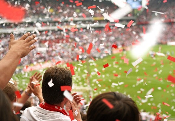 Confetti falls on the crowd at a soccer stadium.
