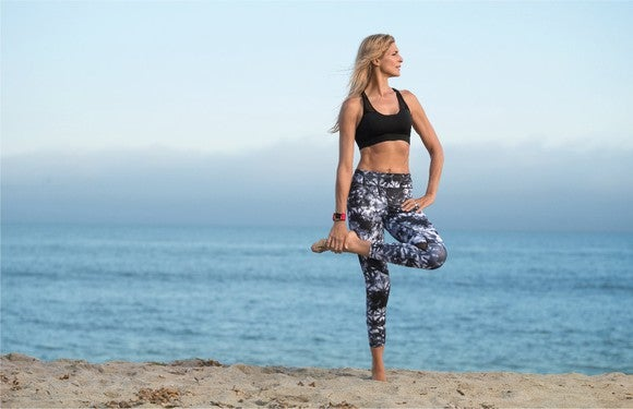 Professional volleyball player Gabby Reece wears a Fitbit Surge.