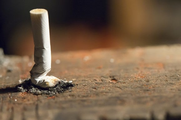 A cigarette extinguished on the ground.