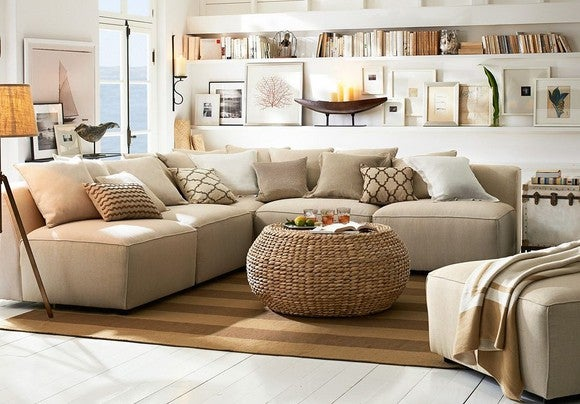 Nicely decorated room with beige and tan colors by Pottery Barn