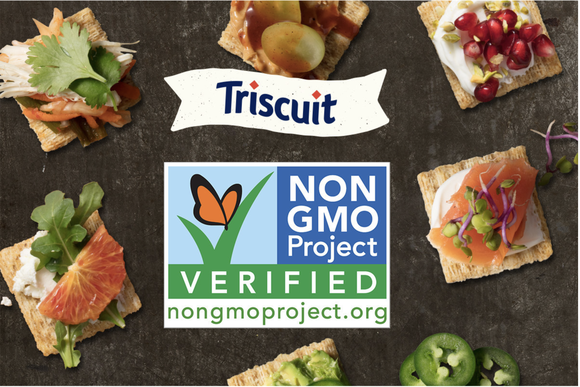 Triscuit logo above a non GMO verified logo with several Triscuits topped with different vegetable ingredients scattered around a table top.